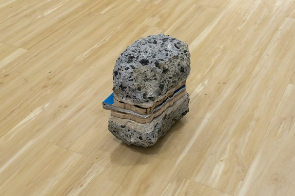 Rafael Domenech, <em>Bad infinities: laboratory of fragments, Heteroglossic city,</em> 2019-20. Unique object, found concrete rock, laser-print on paper, tape, book-cloth.