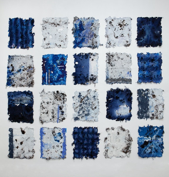 Adebunmi Gbadebo, <em>Blues People</em>, 2020. Black hair, cotton, rice paper, indigo dye and printed photographs on rice paper, 110 x 120 inches, 24 x 20 inches each (variable). Courtesy False Flag.