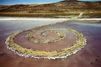 Robert Smithson, <em>Spiral Jetty</em>  (1970). Great Salt Lake, Utah. Mud, precipitated salt crystals, rocks, water. 1,500 ft. (457.2 meters) long and 15 ft. (4.6 meters) wide. Collection of Dia Art Foundation. Photograph: Gianfranco Gorgoni. © Holt/Smithson Foundation and Dia Art Foundation, Licensed by VAGA at ARS, New York.