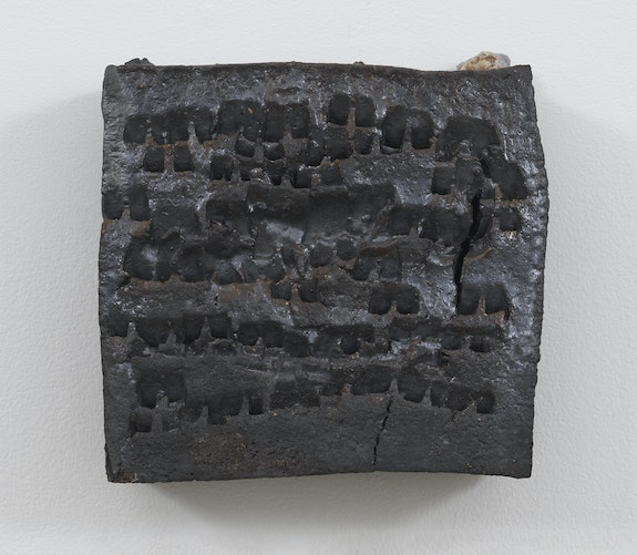 Theaster Gates, <em>Brick Reliquary - Square with Marks</em>, 2020. Wood fired brick, wood ash, magnesium dioxide, and black stain, 12 x 12 x 4 inches. © Theaster Gates. Photo: Robert McKeever. Courtesy Gagosian.