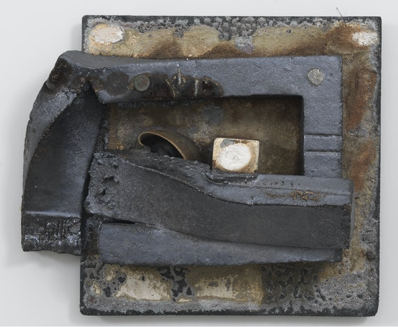 Theaster Gates,<em> Brick Reliquary - Tea Compression of Rectangle with Melted Bowl</em>, 2020. Stoneware tea bowl, kiln post, refractory clay, wood fired brick, wood ash, magnesium dioxide, black stain, and alumna carbide shelf, 18 x 22 x 9 inches. © Theaster Gates. Photo: Robert McKeever. Courtesy Gagosian.