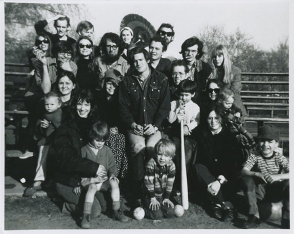 Best and Company picnic, Staten Island Ballfield, Easter Sunday, 1968. Back row, left to right: Peter Schjeldahl (with hand on head), Jim Carroll, Linda Schjeldahl, George Kimball. Next row, left to right: Susan Kimball (with dark glasses), Lewis Warsh, Anne Waldman, Ted Berrigan, Bill Berkson, George Schneeman, Ron Padgett, Dick Gallup (with cigarette), Carol Gallup. New row, left to write: Tessie Mitchell (holding Gwen Rivers), Sandy Berrigan (with hat and polka dot dress), Emilio Schneeman (kneeling between two baseballs), David Berrigan (holding baseball bat), Pat Padgett (wearing sunglasses, holding Wayne Padgett), Joan Fagin (wearing wristwatch), Elio Schneeman (in striped shirt).  Photo: Larry Fagin.