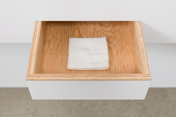 Haim Steinbach, <em>Untitled (box with handkerchief - Bess)</em> (detail), 1993. Plastic laminate and wood box; embroidered cloth handkerchief, 48 x 36 x 14 inches. Courtesy the artist and Tanya Bonakdar Gallery, New York / Los Angeles. Photo: Pierre Le Hors.