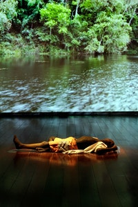 Caetano Dias, <em>Indigent Lake</em>, 2008. Installation composed of a body in cast sugar and video projection of a paradisiacal lake. Courtesy the artist.