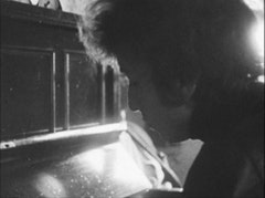 Dylan at typewriter: Photo © Ashes and Sand, Inc.
