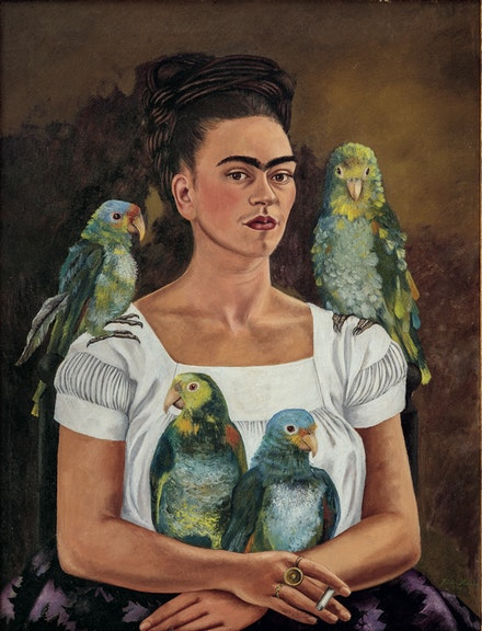 Frida Kahlo, <em>Me and My Parrots</em>, 1941. Oil on canvas, 32 5/16 × 24 3/4 inches. Private collection. © 2020 Banco de México Diego Rivera Frida Kahlo Museums Trust, Mexico, D.F. / Artists Rights Society (ARS), New York.