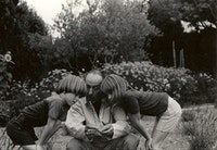 René Char in his garden, showing Matthew and Hilary Caws a sprig of lavender.