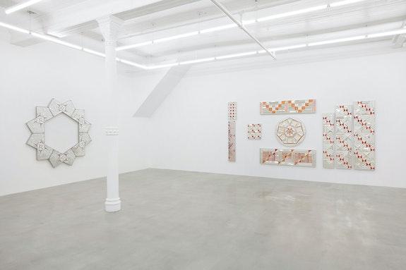 Installation view: <em>Monir Shahroudy Farmanfarmaian: Mirror-works and Drawings (2004–2016)</em>, James Cohan, New York. © Estate of Monir Shahroudy Farmanfarmaian 2021. Courtesy the estate and James Cohan, New York. Photo: Phoebe d'Heurle.