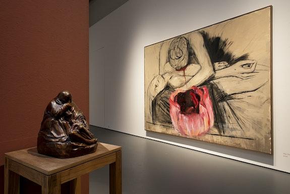 Installation view: <em>Enrique Martínez Celaya and Käthe Kollwitz: Von den ersten und den letzten Dingen (Of First and Last Things)</em>, Galerie Judin, Berlin, 2021. From left: Käthe Kollwitz, Mother with Her Dead Son (Pietá), 1937/38. Bronze, 15 x 11.25 x 15 3/8 inches; Enrique Martínez Celaya, The Child's Song, 2020. Oil and wax on canvas, 116 x 150 inches. Courtesy of Galerie Judin, Berlin.
