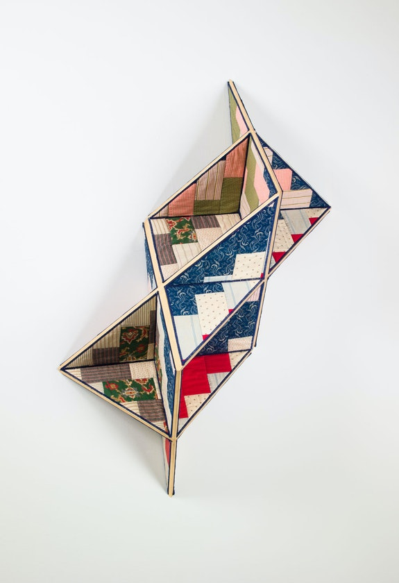 Sanford Biggers,<em> Incidental Geometry</em>, 2017. Antique quilt, birch plywood, gold leaf. 45 1/2 x 37 1/2 x 16 inches. Courtesy the artist and Marianne Boesky Gallery, New York.