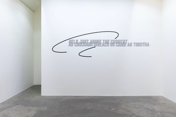 Lawrence Weiner, <em>HELD JUST ABOVE THE CURRENT</em>, 2016. Language + the materials referred to, dimensions variable. Courtesy the artist and Kerlin Gallery, Dublin.