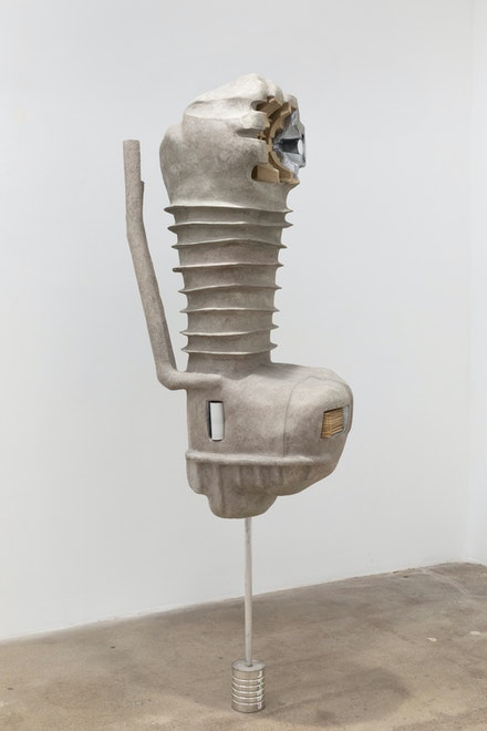 Louis Osmosis, <em>Engine</em>, 2020. Reinforced paper-mache,polyurethane foam, aluminumtubing, toilet paper tube,popsicle sticks, blind spot mirror,paper pulp packaging, coffee can,acrylic paint, epoxy, cement, 73 x 24 x 15 inches. Courtesy Hesse Flatow.