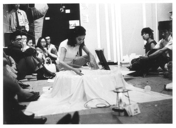 Mieko Shiomi, <em>Water Music</em>, performance during the Flux Week at Gallery Crystal, Tokyo, 1965. Photo: Teruo Nishiyama.