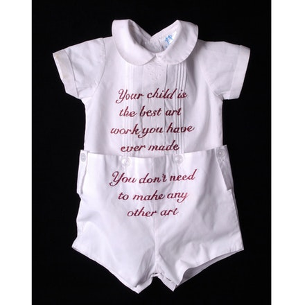 Miriam Schaer, <em>Your Child is the Best Art You Have Ever Made. You Don't Need to Make Any Other Art Work</em>, 2012-14. Hand embroidery on baby romper, quote from interview with artist mother, from her family, 19 x 15 inches.