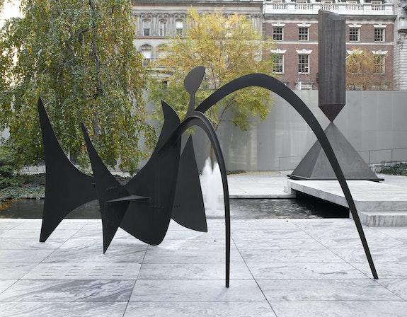 Alexander Calder, <em>Black Widow</em>, 1959. Painted sheet steel. 92 x 171 x 89 inches. The Museum of Modern Art, New York. Mrs. Simon Guggenheim Fund. © 2021 Calder Foundation, New York / Artists Rights Society (ARS), New York.