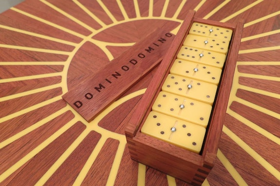 Edra Soto, <em>Dominodomino</em>, 2015. Installation in collaboration with Dan Sullivan. Jatoba wood, Corian inlay, limited edition prints. Courtesy the artist and Luis De Jesus Los Angeles.