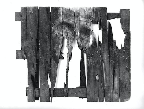 Peter Kennard, <em>Pallet</em>, 1990. Oil, charcoal and dust on wood, 90 x 65 x 14 centimeters. © Peter Kennard. Courtesy the artist and Richard Saltoun Gallery.