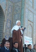 Sheikh Abbas holds a sword symbolizing the Shia struggle for justice as he addresses thousands of followers, February 2004.