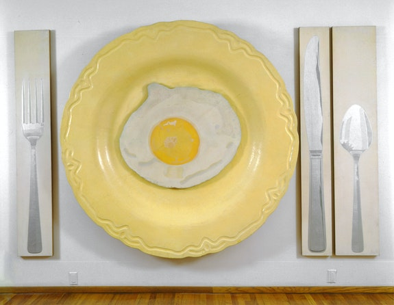 Alex Hay, <em>Egg on Plate with Fork, Knife, and Spoon</em>, 1964. Spray lacquer and stencil on linen, 86 x 140 1/4 x 6 3/4 inches; (218.44 x 356.24 x 17.14 cm) overall. Courtesy the artist and Peter Freeman, Inc., New York.