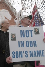 Monday March 17, 2003 Washington DC : Bob McIlvaine holds a sign with pictures of his son who died in the WTC.