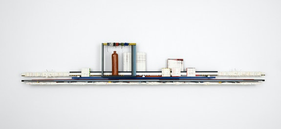 Remy Jungerman, <em>Horizontal Obeah MAAU (LA LLORONA)</em>, 2020. Cotton textile, kaolin, gin bottle, tar, beads, nails, yarn, acrylic, wood, 112 x 19 x 7 inches. Courtesy Fridman Gallery, New York.