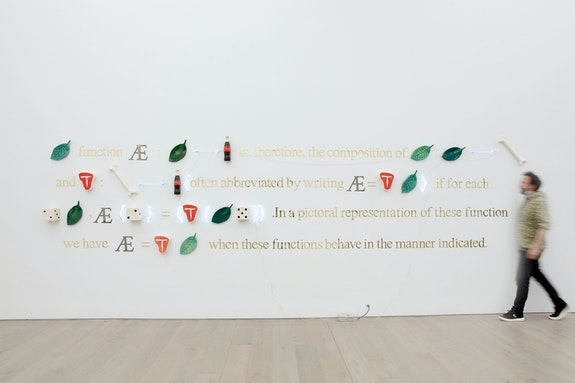 Gabriel Rico, <em>Rather than the obvious object (Theorem)</em>, 2021. Ceramic, mirror, neon, brass, 58 1⁄4 x 248 1/16 x 5 1⁄2 inches. Photo: Guillaume Ziccarelli. Courtesy the artist and Perrotin.