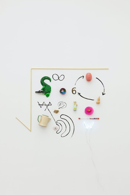 Gabriel Rico, <em>VI from the series –The poller and exactor of fees–</em>, 2021. Rock, brass, neon, mixed media, 39 3/8 x 51 9/16 x 4 3⁄4 inches. Photo: Guillaume Ziccarelli. Courtesy the artist and Perrotin.