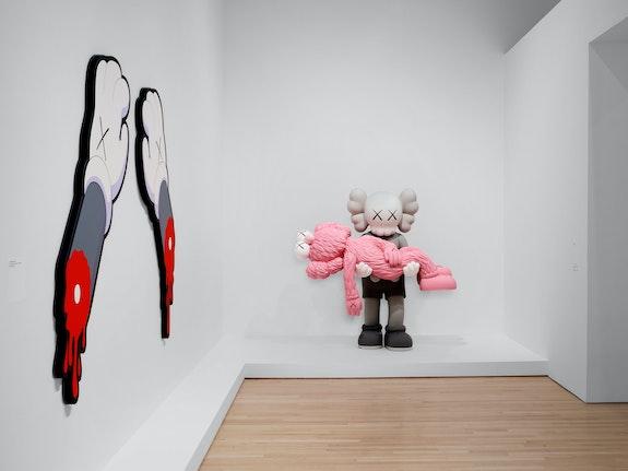 KAWS, <em>NEW MORNING</em> (2012) and <em>GONE</em> (2020) installed at Brooklyn Museum, New York, 2021. © KAWS. Photo: Michael Biondo. Courtesy the artist.