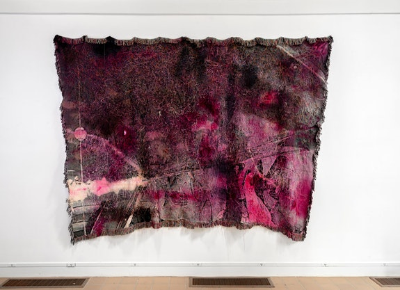 Noel W. Anderson, <em>Hood Reflec/x/tions</em>, 2021. Laser-cut basketball leather, magenta mirror, photographic object, bottle caps, foil, metal leaf, bleach, and dye on distressed, stretched cotton tapestry. 82 x 115 in. Courtesy the artist and JDJ.