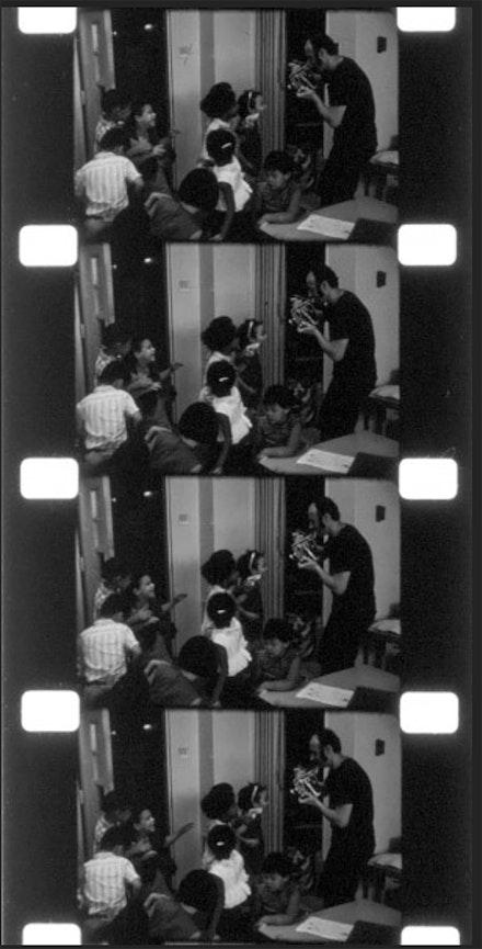 Aldo filming children, undated, from the Harvard Film Archive.