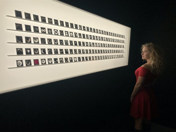 Maggie Clapis in front of Aldo Tambellini's