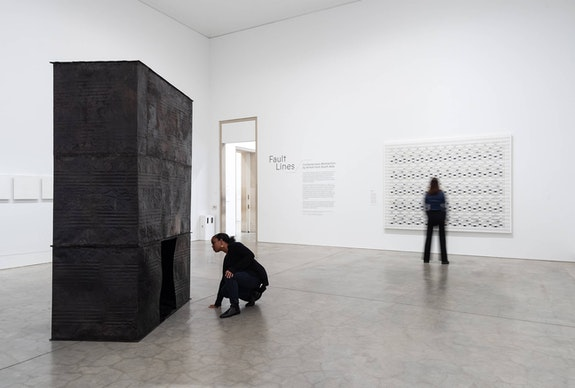 Left to right: Sheela Gowda, <em>A Blanket and the Sky,</em> 2004. Tar drum sheets, blanket. 262 x 157 x 88 cm. Collection of Thomas Erben, New York. Tanya Goel, <em>notation in x, y, z,</em> 2015. Graphite, pigment, and oil on canvas. Courtesy the Philadelphia Museum of Art. Photo: Joseph Hu, 2020.