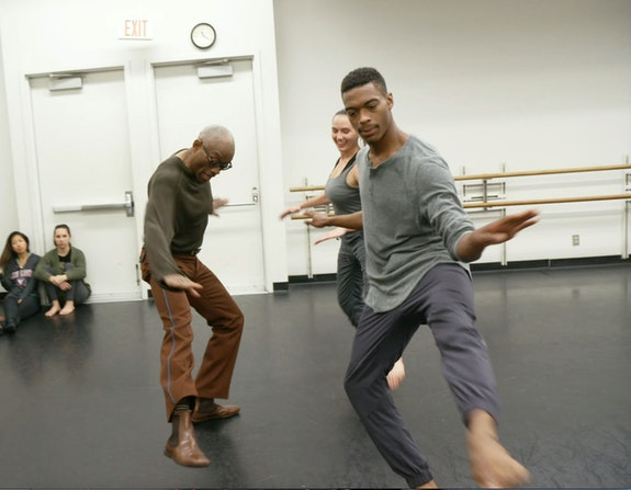 Bill T. Jones in rehearsal doing Astaire steps with students Brandon and Nicole. Photo: Rosalynde LeBlanc.