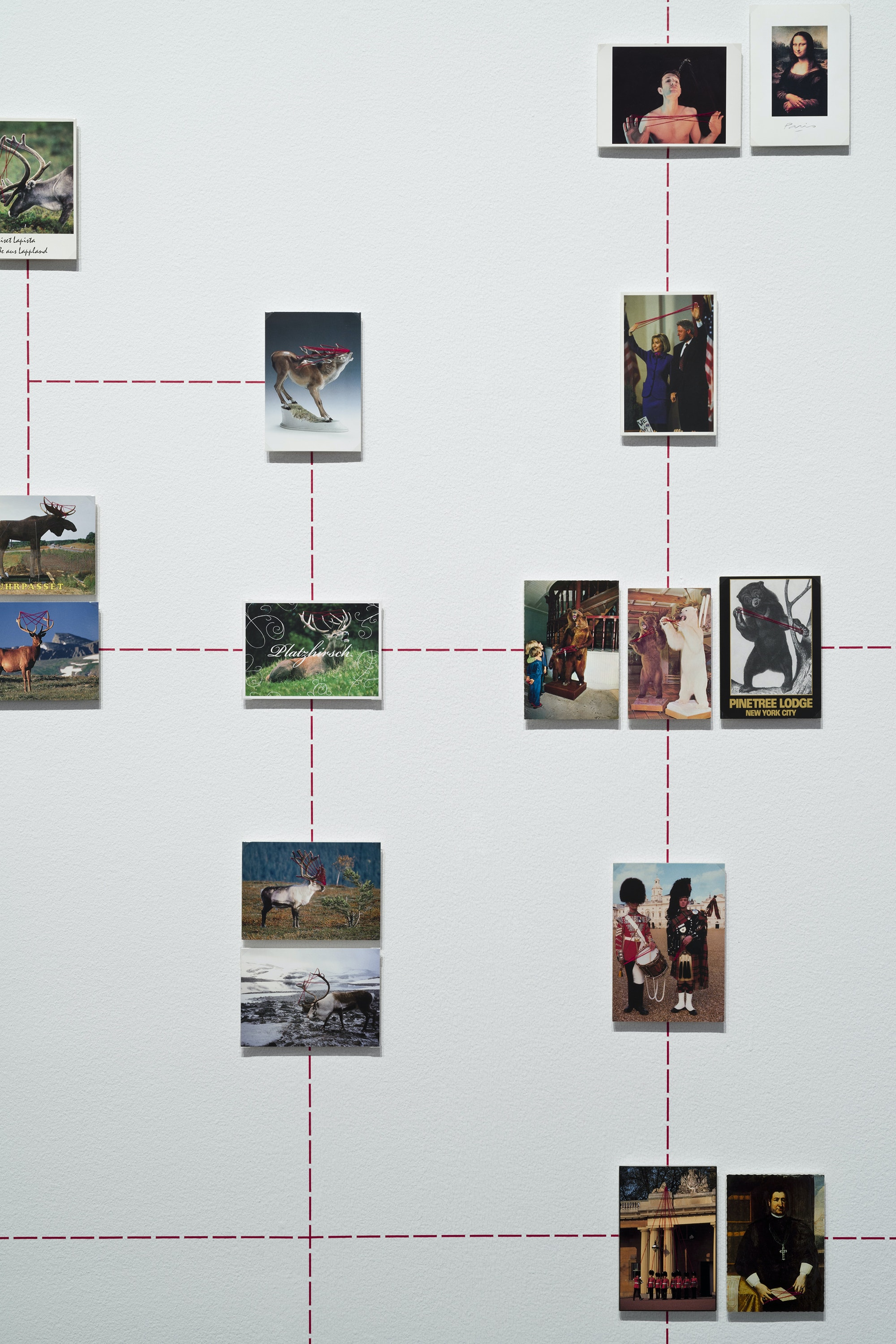 Nina Katchadourian, <em>Paranormal Postcards</em> (detail), 2001–ongoing. Mounted postcards, red sewing thread, red graphic tape on wall, dimensions variable. © Nina Katchadourian. Courtesy Pace Gallery.