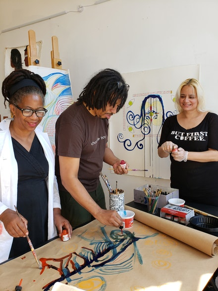 Karen Gormandy (left) working with artists Issa Ibrahim and Susan Spangenberg at Fountain House Studio. Courtesy Fountain House Gallery.