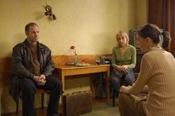 Vlad Ivanov, Anamaria Marinca and Laura Vasiliu lay the deal down in <i> 4 Months, 3 Weeks and 2 Days. Photo courtesy of Mobra Films/Adi Padretu.</i>