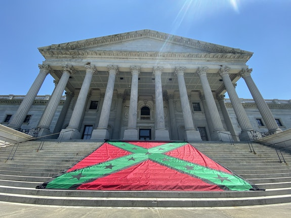 John Sims, <em>AfroConfederate Battle Flag</em>, 2021. 288 × 288 inches. Presented at the Rally Against the Confederate State of Mind: Remembering the Emanuel Nine, at the South Carolina State House, June 17, 2021. Courtesy the artist.