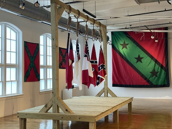 Installation shot of <em>AfroDixia: A Righteous Confiscation</em>, 2021. Featured work: John Sims, <em>The Proper Way to Hang Five Major Confederate Flags</em> 2021, at the 701 Center for Contemporary Art, Columbia, SC. Courtesy the artist.