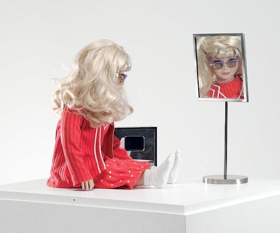 Lynn Hershman Leeson, <em>CyberRoberta</em>, 1996. Custom-made doll, clothing, glasses, webcam, surveillance camera, mirror, original programming, and telerobotic head-rotating system, Aprox. 17 ¾ x 17 ¾  x 7 ⅞  in (45 x 45 x 20 cm). Courtesy the artist; Bridget Donahue Gallery, New York; and Altman Siegel, San Francisco