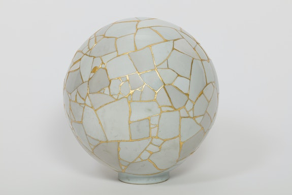 Yee Sookyung, <em>Translated Vases s—The Moon 3</em>, 2007. Ceramic shards, epoxy resin, gold leaves, diameter 13 3/8 inches. © Yee Sookyung. Photo: Sigg Collection, Mauensee.