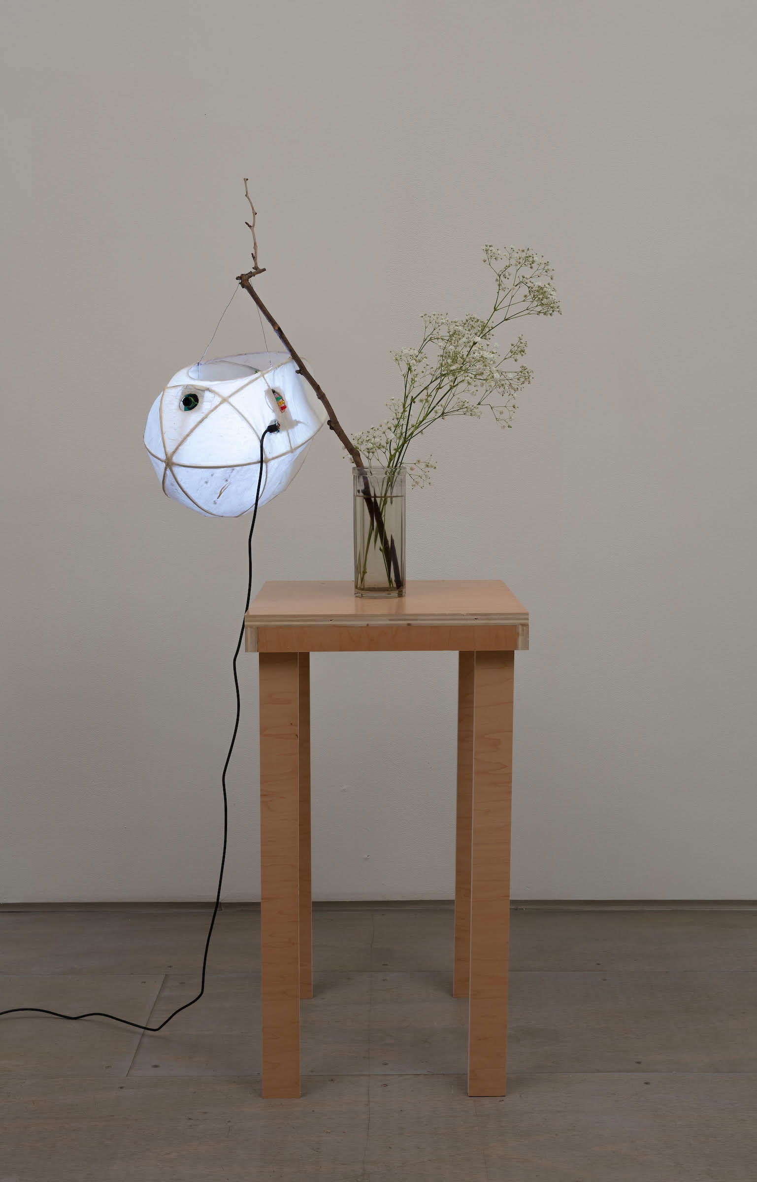 Cici Wu, <em>Foreign Object #2 Umbra and Penumbra (+852 carambola)</em>, 2021. Bamboo wire, paper, glue, metal wire, neopixel led, opencv camera, raspberry pi 4B, power adapter board, switch, led, micro-usb cable, lithium battery, memory card, artist's lantern holder and plinth, 51 1/2 x 20 1/2 x 14 3/4 inches. Courtesy 47 Canal. Photo: Joerg Lohse.