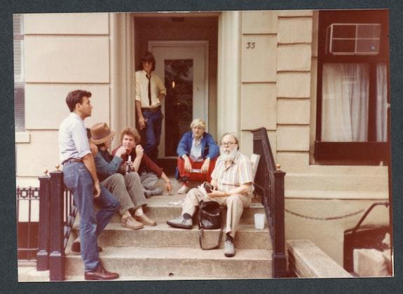 L to R: Diego Cortez, Don Van Vliet, Bradford Morrow, David Fricke, David Hockney, Henry Geldzahler. 33 West 9th Street, NYC, 1982. Photo: Raymond Foye.