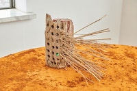 Sophie Friedman-Pappas, <em>City Full of Sticks</em>, 2020. Brick, found object, and plastic sequin, 8 x 3 1/2 x 12 inches. Photo: Timothy Mahoney.