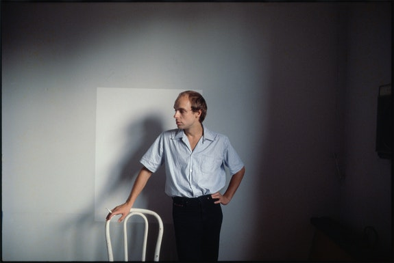 Brian Eno in Steve Mass's apartment on 8th Street, New York City, 1978. Photo by Roberta Bayley.