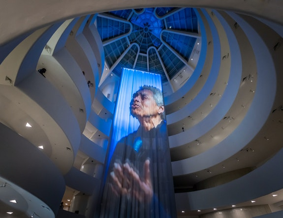 Wu Tsang, <em>Anthem</em>, 2021. Color video, with sound, with fabric and carpet, dimensions vary with installation. Solomon R. Guggenheim Museum, New York. © Wu Tsang. Photo: David Heald. © Solomon R. Guggenheim Museum, 2021.