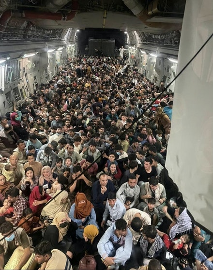 823 Afghan citizens leave from Hamid Karzai International in a U.S. Air Force vessel, 2021. Courtesy the U.S. Air Force.