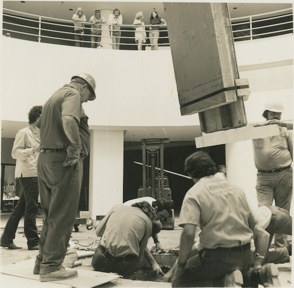 Installing Irwin's thirty-three foot Prism at Northridge Mall, 1971. Jack seated, bends over, his back to the viewer.