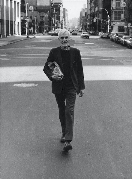 Rudy Burkhardt, <em>Edwin Denby on Sixth Avenue</em>, c. 1970. Silver gelatin print, 8 1/2 x 6 1/2 inches. Courtesy Estate of Rudy Burckhardt and Tibor de Nagy Gallery, New York.