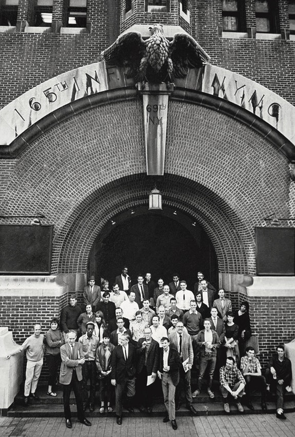 """Peter Moore. Group portrait of many of the """"9 Evenings"""" participating artists and engineers outside the 69th Regiment Armory, New York, October 8, 1966. Peter Moore Photography Archive, Charles Deering McCormick Library of Special Collections, Northwestern University Libraries. © Northwestern University. Courtesy Paula Cooper Gallery, New York."""