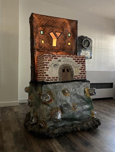 Liz Ahn, <em>grandpa's YMCA</em>, 2021. Wood, foam, canvas, LED lights, cement, sand, paint, 58 x 29 x 29 inches. Courtesy Backyard Ghost.